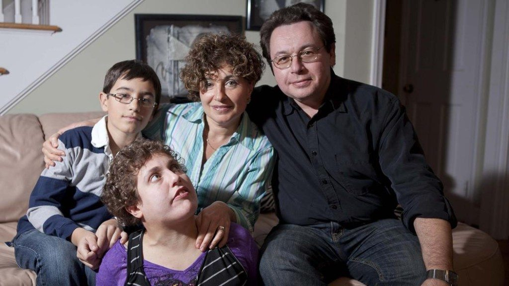 Eric Zeiberg, 12, left, sits with mother and father, Maya and Boris, Zeiberg and big sister, Julie Zeiberg, 22, in their West Hartford home. Johnathon Henninge/ Hartford Courant