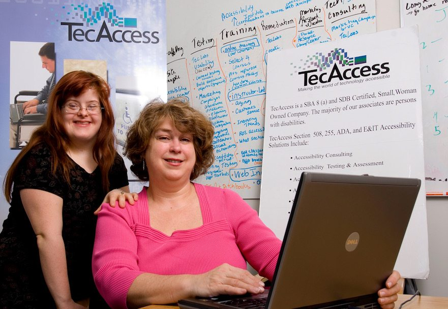 Sara and Debra Ruh photographed when working at TecAcces, Debra's first entrepreneurial endeavor.
